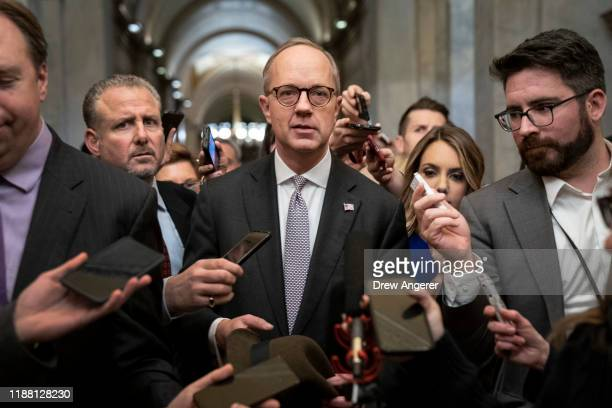 Reporters surround White House Legislative Affairs director Eric Ueland as he leaves the office of Senate Majority Leader Mitch McConnell after...