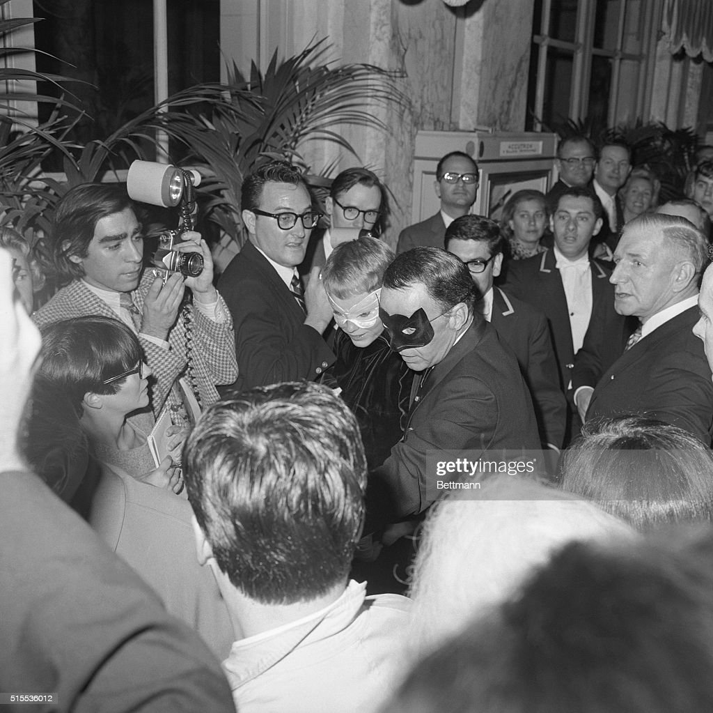 Reporters swarm Frank Sinatra and his wife actress Mia Farrow as they arrive at  sc 1 st  Getty Images & Mia Farrow and Husband Frank Sinatra Going to Costume Party Pictures ...