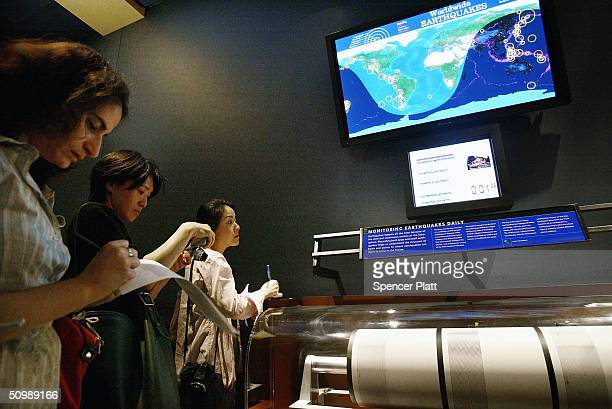 Reporters take notes at the new earthquake monitoring station June 23 2004 at the Museum of Natural History in New York City On exhibit in the...