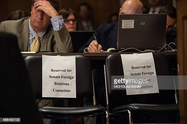 Reporters take notes during a Senate Foreign Relations Committee hearing on the situation in Ukraine on Capitol Hill in Washington on May 6 2014 AFP...