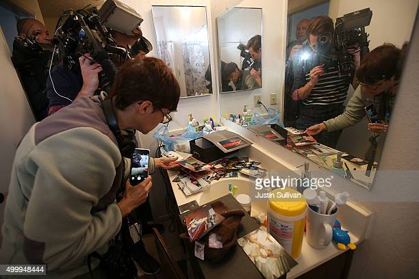 Reporters take pictures of photographs found inside the home of shooting suspect Syed Farook on December 4, 2015 in Redlands, California. The San...
