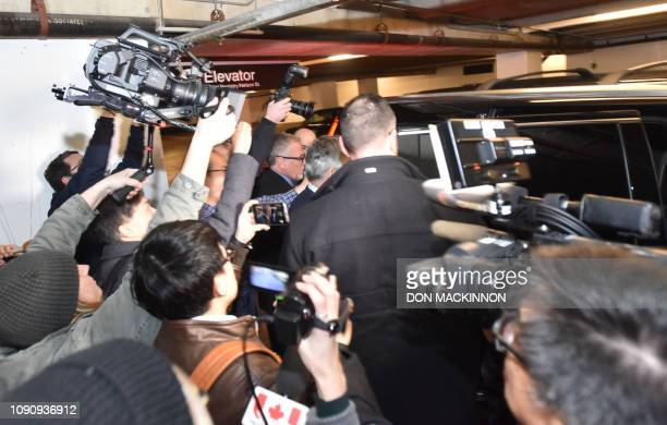 Reporters try to record the arrival of Meng Wanzhou Huawei's chief financial officer and the daughter of its founder at the Vancouver Law Courts on...