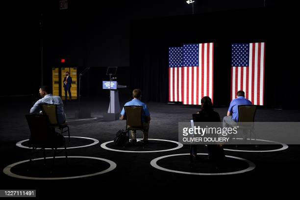"""Reporters wait for Democratic presidential candidate and former Vice President Joe Biden to arrive to speak at a """"Build Back Better"""" Clean Energy..."""