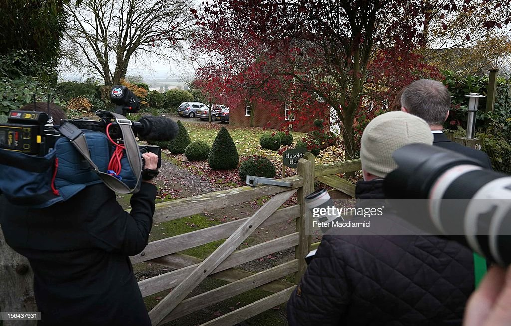 Reporters wait outside a house belonging to former Radio One disc jockey Dave Lee Travis on November 15, 2012 near Leighton Buzzard, England. According to reports, Dave Lee Travis has been arrested by police on Operation Yewtree - the investigation that began in the wake of allegations made against the late Jimmy Savile.