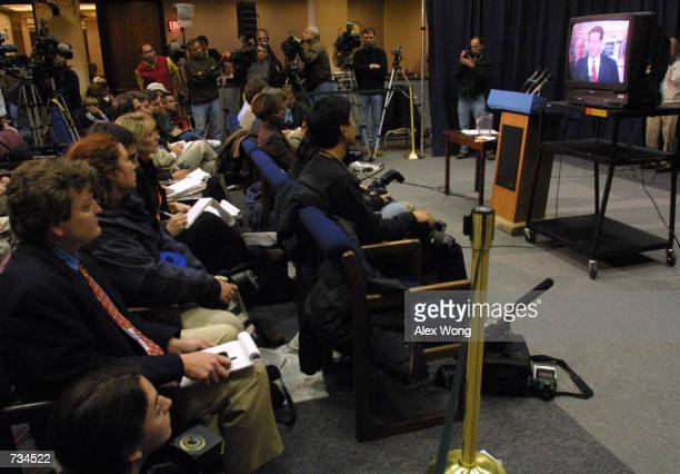 Reporters watch Democratic presidential candidate Vice President Al Gore making statement responding a court ruling on television November 21 2000 at...