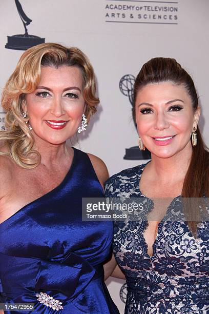 Reporters Wendy Burch and Ana Garcia attend the Academy Of Television Arts Sciences 65th Los Angeles Area EMMY Awards held at the Leonard H Goldenson...