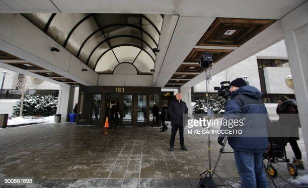 reporters work outside the courthouse in Ottawa Canada January 3 2018 where former Taliban hostage Joshua Boyle briefly appeared via video link to...