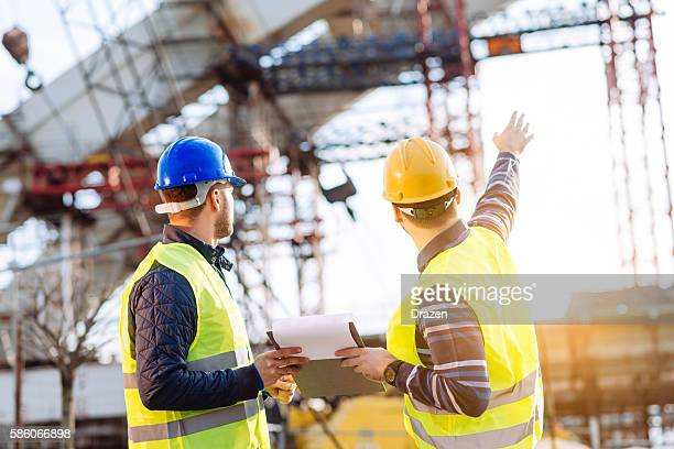reporting to contractor at construction site - man made structure stock pictures, royalty-free photos & images