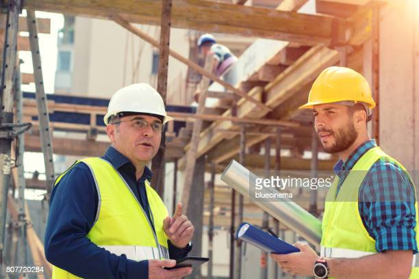 Reporting to contractor at construction site