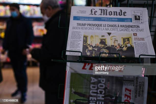 Reports on the unrest in the U.S. Capitol on the front page of French newspaper Le Monde in a news agents in Paris, France, on Thursday, Jan. 7,...