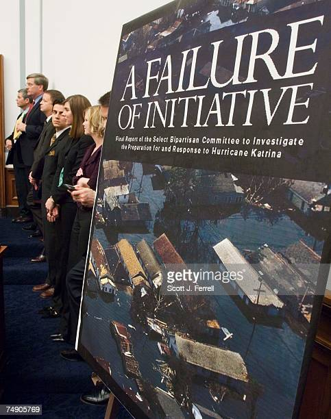REPORTStaff stands near a poster of the cover of the House Select Katrina Response Investigation panel's report as it met to consider its final...