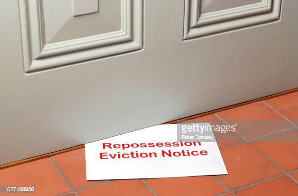 repossession eviction notice pushed under front door - failure stock pictures, royalty-free photos & images