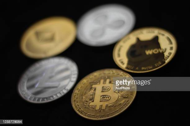 Representation of cryptocurrencies are seen in this illustration photo taken in Krakow, Poland on June 29, 2021