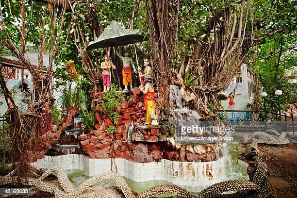 Representation of Lord Krishna raising Mount Govardhan in a park Rajkot Gujarat India
