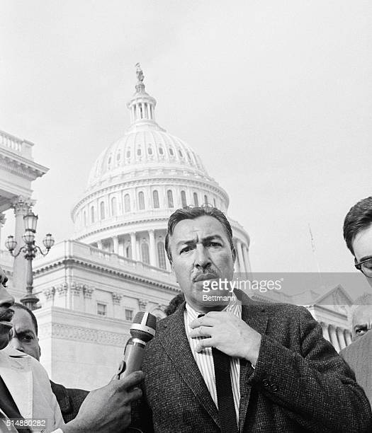 Representative Adam Clayton Powell Jr talks to the press outside the Capitol after being ousted as chairman of the Committee on Education and Labor...
