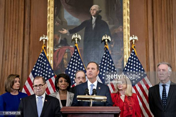 Representative Adam Schiff, a Democrat from California and chairman of the House Intelligence Committee, center, speaks as Representative Richard...
