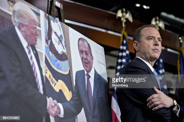 Representative Adam Schiff a Democrat from California and ranking member of the House Intelligence Committee stands next to a photograph of US Donald...