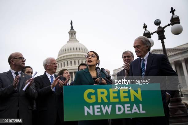 Representative Alexandria OcasioCortez a Democrat from New York speaks as Senator Ed Markey a Democrat from Massachusetts right listens during a news...