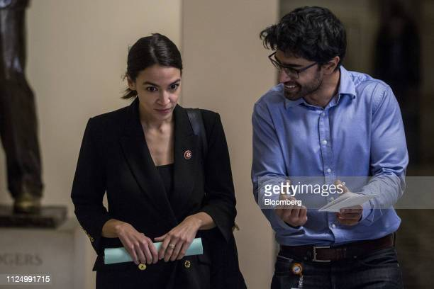 Representative Alexandria OcasioCortez a Democrat from New York left walks to the House Chamber on Capitol Hill in Washington DC US on Feb 14 2019...