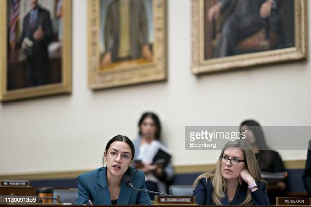 Representative Alexandria OcasioCortez a Democrat from New York left questions Tim Sloan president and chief executive officer of Wells Fargo Co not...