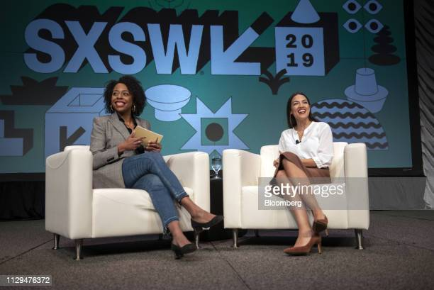 Representative Alexandria OcasioCortez a Democrat from New York right reacts during the South By Southwest conference in Austin Texas US on Saturday...