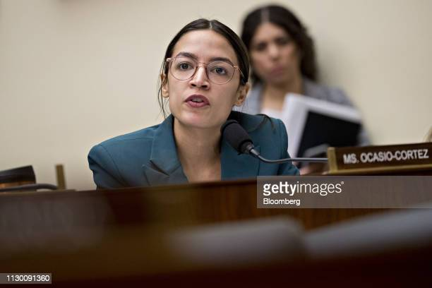 Representative Alexandria OcasioCortez a Democrat from New York questions Tim Sloan president and chief executive officer of Wells Fargo Co not...