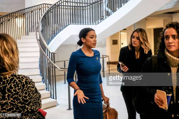 Representative Alexandria OcasioCortez a Democrat from New York speaks to members of the media while arriving for closeddoor testimony before House...