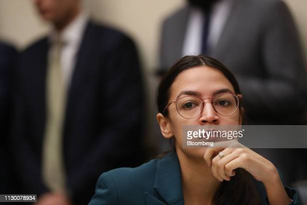 Representative Alexandria OcasioCortez a Democrat from New York waits for the start of a House Financial Services Committee hearing with Tim Sloan...