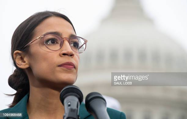 US Representative Alexandria OcasioCortez Democrat of New York speaks during a press conference to announce Green New Deal legislation to promote...