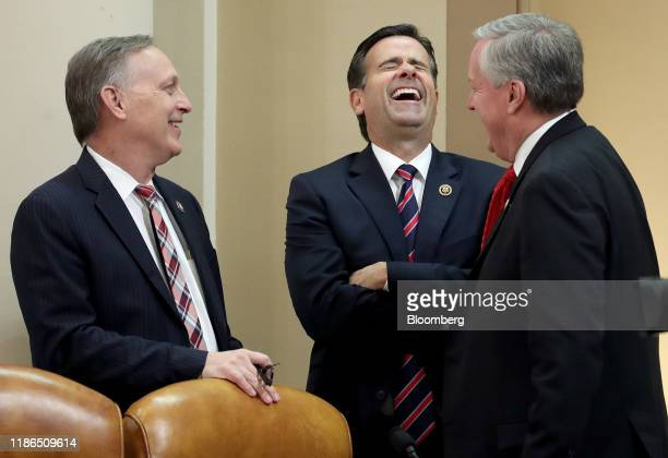 Representative Andy Biggs, a Republican from Arizona, Representative John Ratcliffe, a Republican from Texas, and Representative Mark Meadows, a...