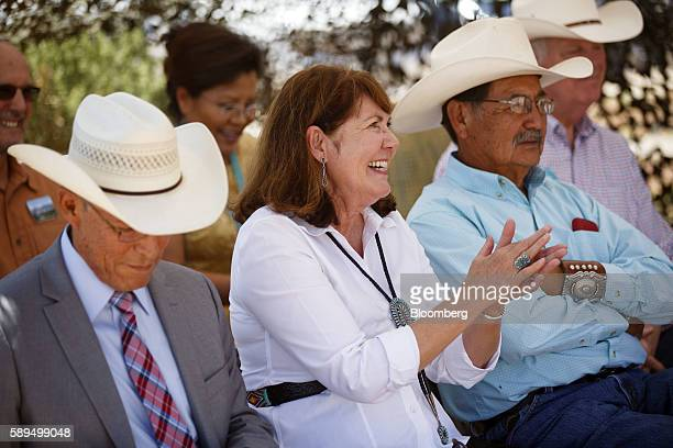 Representative Ann Kirkpatrick a Democrat from Arizona center applauds during a campaign event on the Navajo Nation Native American Reservation ahead...