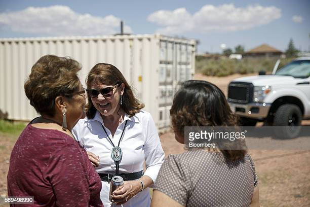Representative Ann Kirkpatrick a Democrat from Arizona center greets attendees during a campaign event on the Navajo Nation Native American...