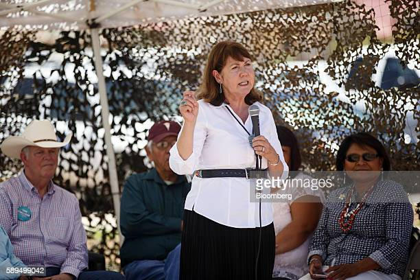 Representative Ann Kirkpatrick a Democrat from Arizona center speaks during a campaign event on the Navajo Nation Native American Reservation ahead...