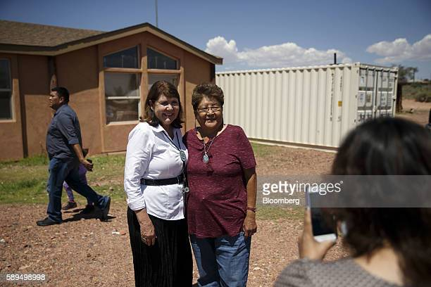 Representative Ann Kirkpatrick a Democrat from Arizona left stands for a photograph with an attendee during a campaign event on the Navajo Nation...