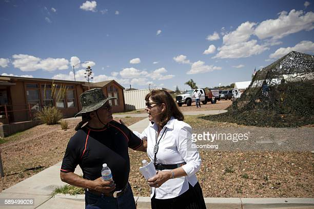 Representative Ann Kirkpatrick a Democrat from Arizona right speaks with an attendee during a campaign event on the Navajo Nation Native American...