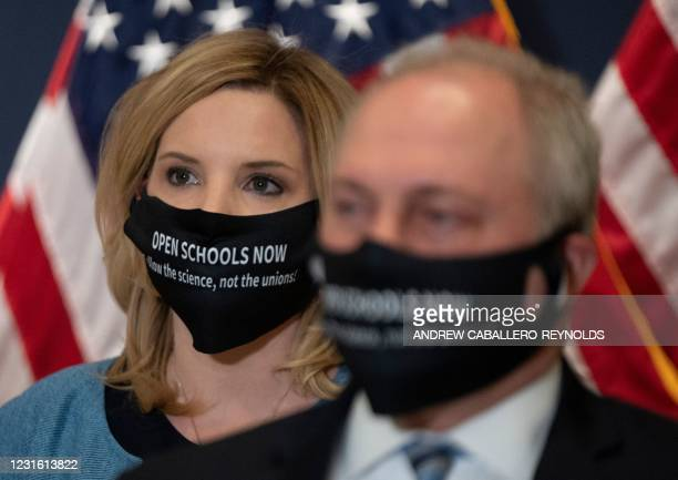 Representative Ashley Hinson and Steve Scalise look on during a House Republican press conference on Capitol Hill in Washington, DC on March 9, 2021.