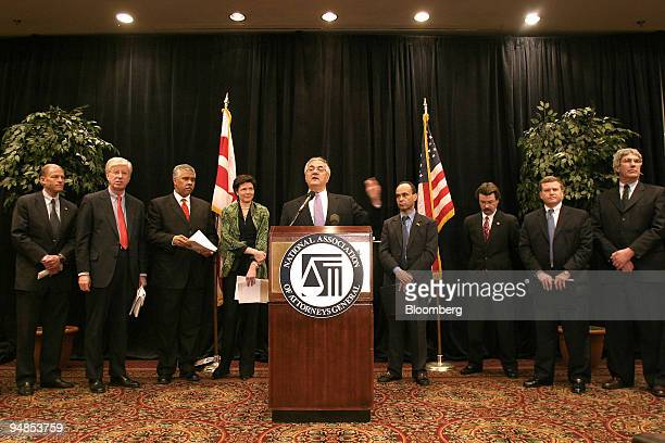 S Representative Barney Frank at podium and other government officials and consumer representatives hold a news conference sponsored by the National...
