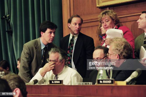 Representative Barney Frank surrounded by aides and colleagues during deliberations of the House Judiciary Committee proposed impeachment of...
