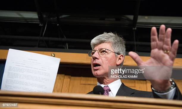 Representative Bart Stupak of Michigan, head of a group of pro-life Democrats, holds up a copy of an Executive Order banning use of Federal funds to...