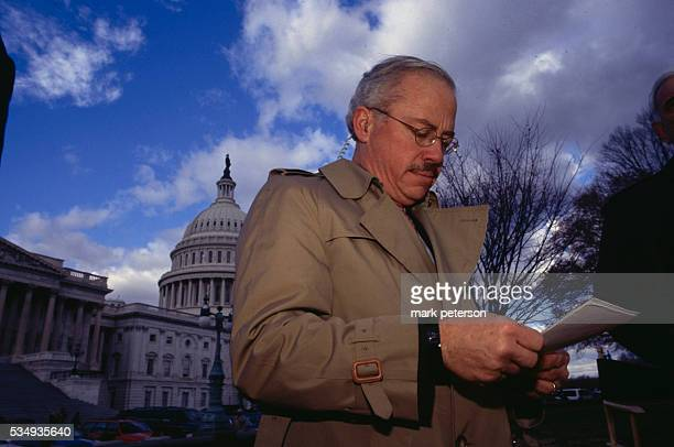 Representative Bob Barr who led the charge to impeach President Bill Clinton stands in front of the Capiton Building in Washington DC