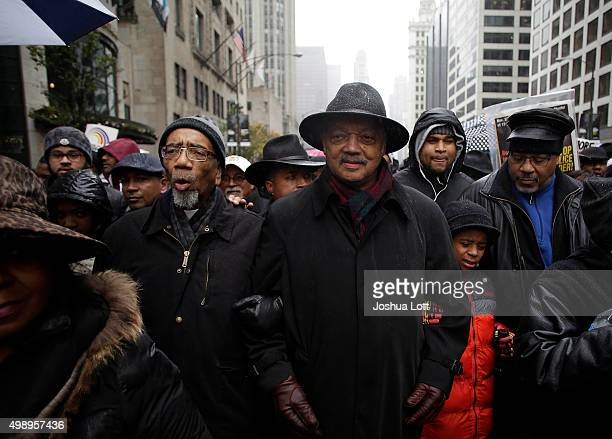 S Representative Bobby Rush and Reverend Jesse Jackson link arms as they march with demonstrators protesting the shooting of Laquan McDonald along...