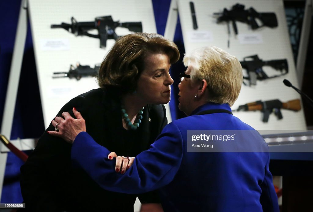 U.S. Representative Carolyn McCarthy (D-NY) (R) is greeted by U.S. Senator Dianne Feinstein (D-CA) (L) during a news conference January 24, 2013 on Capitol Hill in Washington, DC. Feinstein announced that she will introduce a bill to ban assault weapons and high-capacity magazines capable of holding more than 10 rounds to help to stop gun violence.