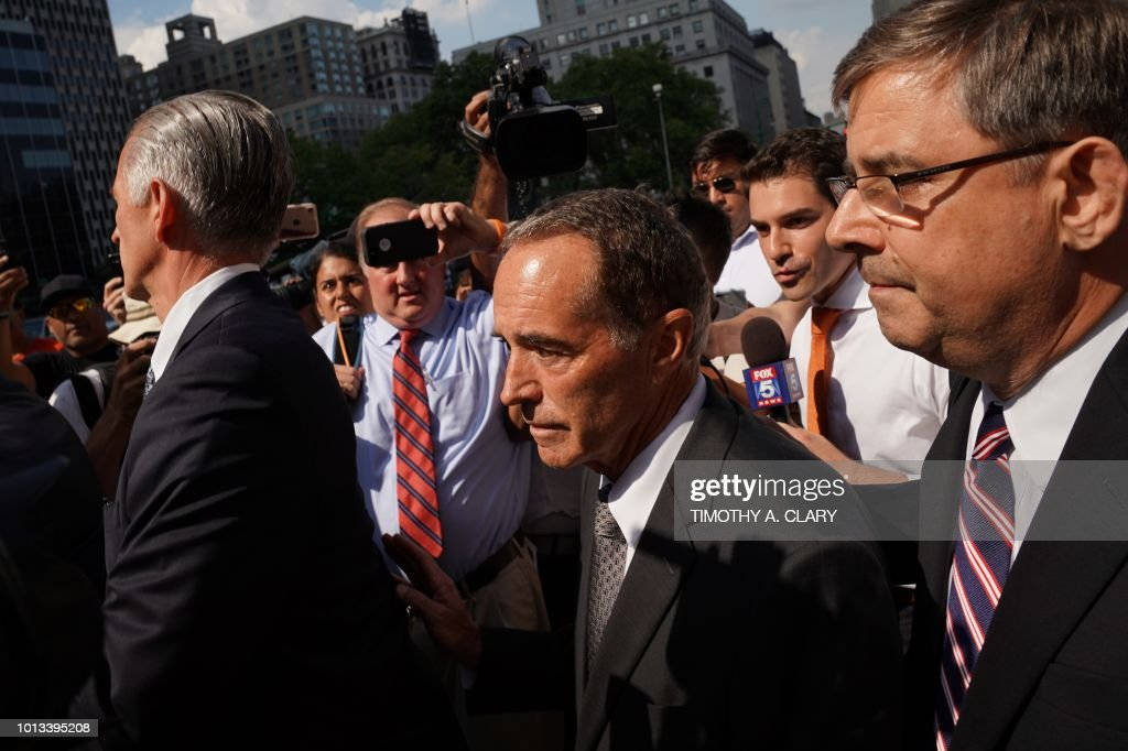 US Representative Chris Collins (C), a Republican from the 27th Congressional District of New York, leaves US Federal Court in New York on August 8, 2018 after being indicted on insider trading - Collins, one of the first US lawmakers to declare support for Donald Trump's presidential candidacy, was indicted by federal prosecutors Wednesday on charges of securities fraud connected to an alleged insider trading scheme.