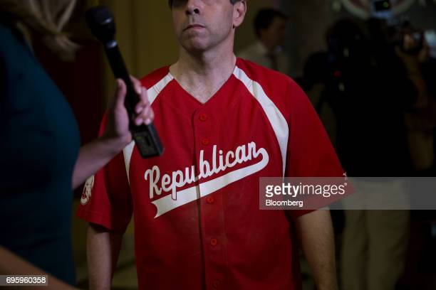 Representative Chuck Fleischmann a Republican from Tennessee wears a baseball uniform while listening to a question from a member of the media at the...