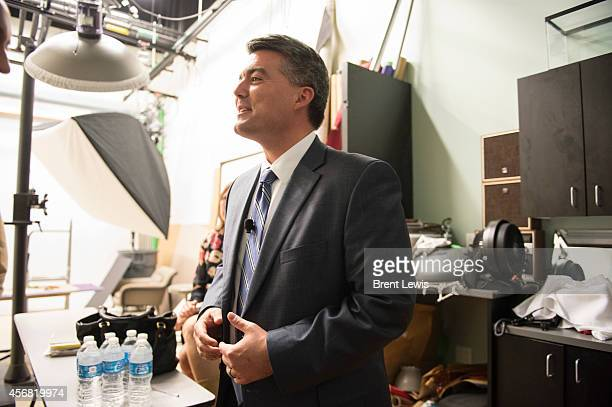 US Representative Cory Gardner fixes his jacket after being wired for the debate Tuesday October 7 2014 in the auditorium of The Denver Post in...