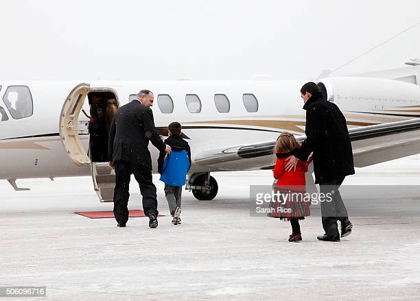 S Representative Dan Kildee left brings the nephew and niece of Amir Hekmati the plane to welcome him home January 21 2016 in Flint Michigan Kildee...