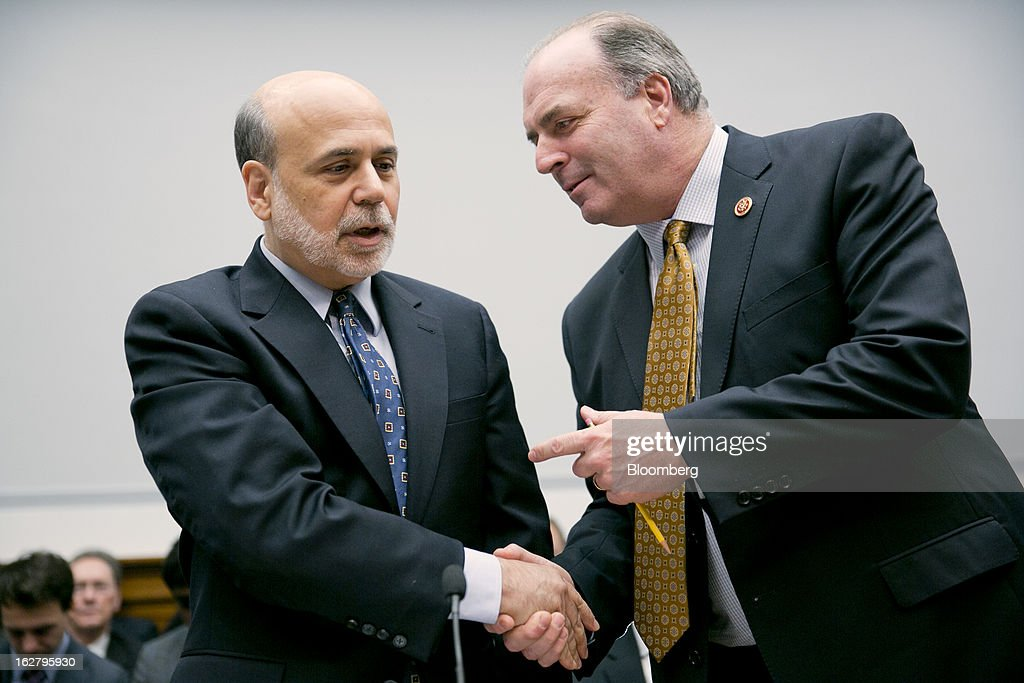 Representative Daniel 'Dan' Kildee, a Democrat from Michigan, right, greets Ben S. Bernanke, chairman of the U.S. Federal Reserve, before the start of a House Financial Services Committee hearing in Washington, D.C., U.S., on Wednesday, Feb. 27, 2013. Bernanke signaled the Fed is prepared to keep buying bonds at its present pace as he dismissed concerns record easing risks sparking inflation or fueling asset price bubbles. Photographer: Andrew Harrer/Bloomberg via Getty Images