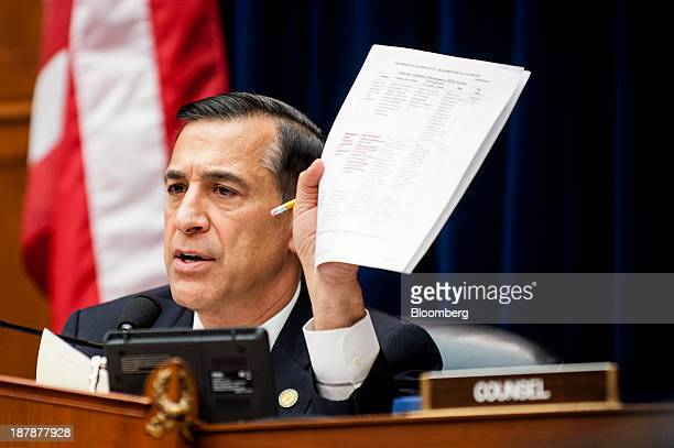 Representative Darrell Issa a Republican from California refers to a document while he chairs a House Oversight and Government Reform Committee...