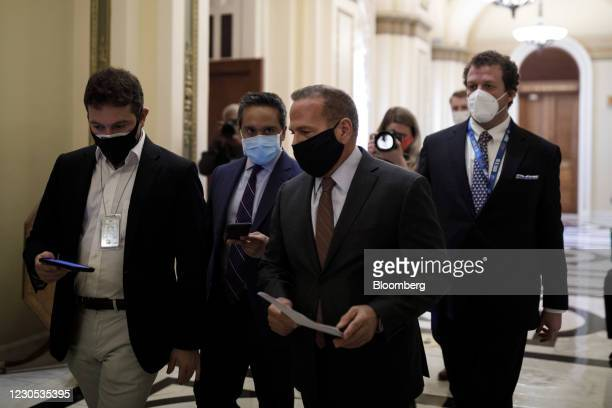 Representative David Cicilline, a Democrat from Rhode Island, wears a protective mask while speaking to member of the media at the U.S. Capitol in...