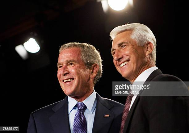 Representative David Reichert RWA smiles after introducing US President George W Bush at a fundraiser for Reichert and the Washington State...
